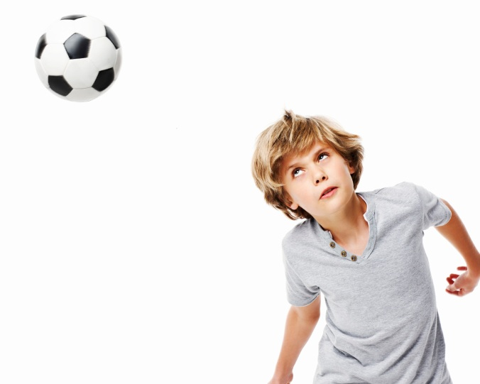 Boy Heading a Soccer Ball - Isolated